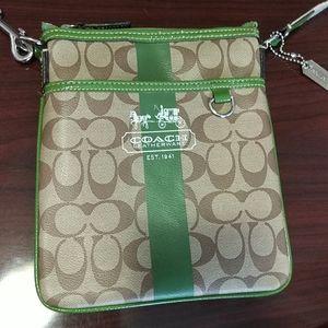 Coach small cross body purse.